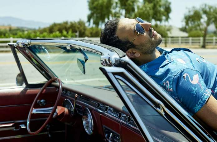 Desmin Borges posing with his car