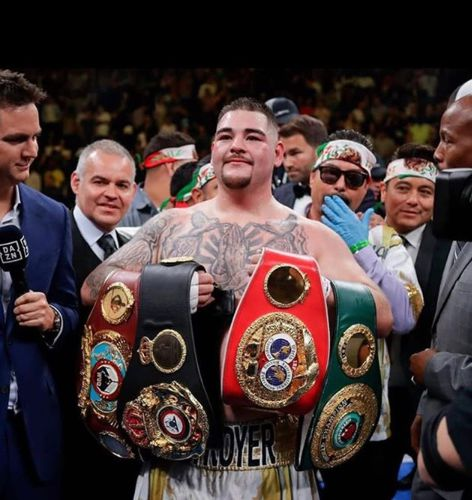 Andy Ruiz Jr with his different tittles