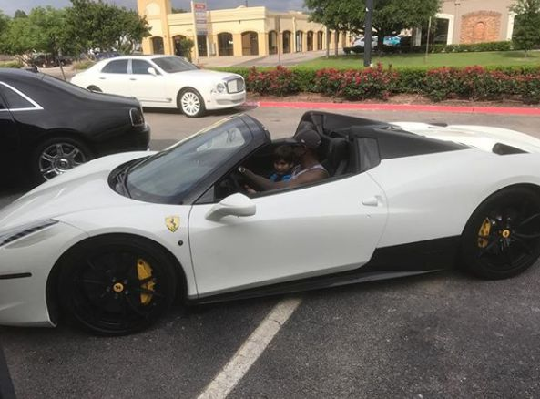 Michael Irvin driving car with his son