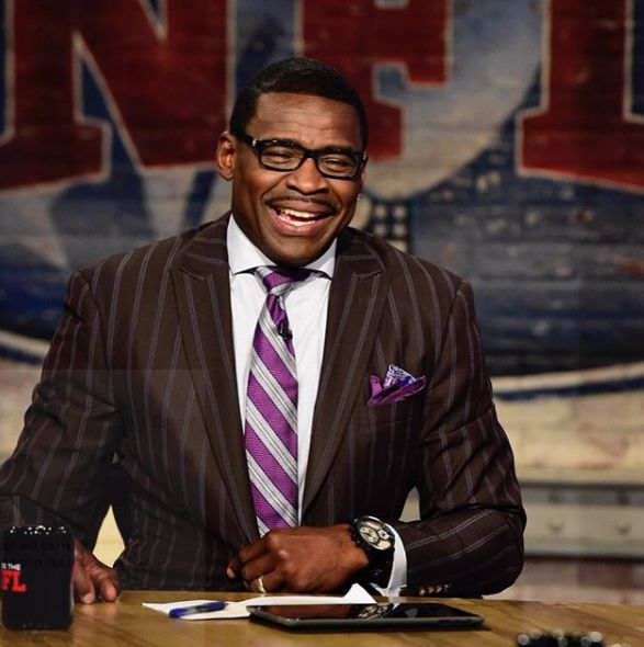 Michael Irvin working as an analyst
