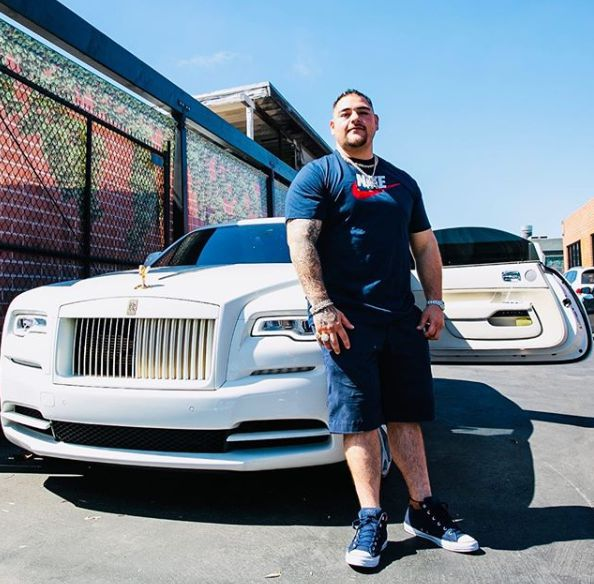 Andy Ruiz Jr in front of his luxurious car