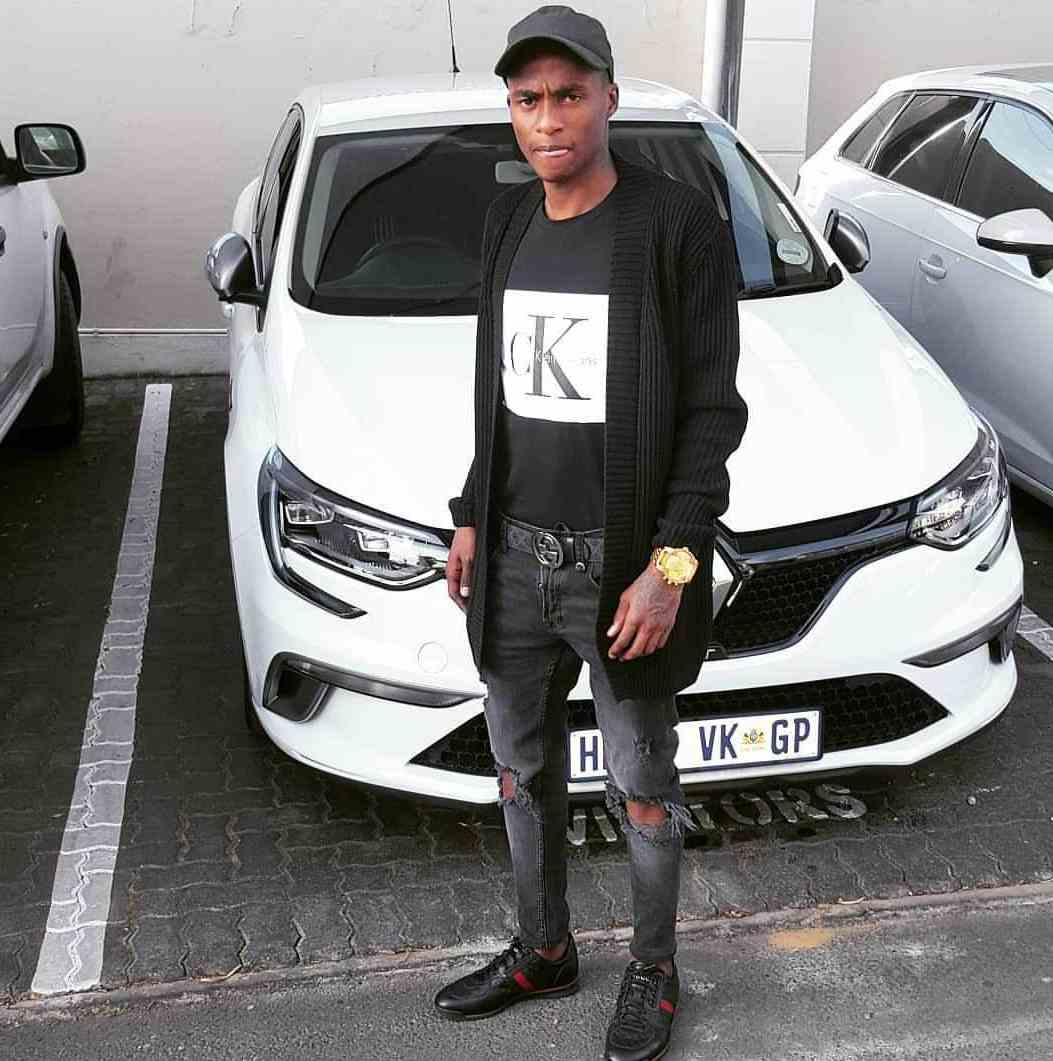 Thembinkosi Lorch posed for picture in front of his car