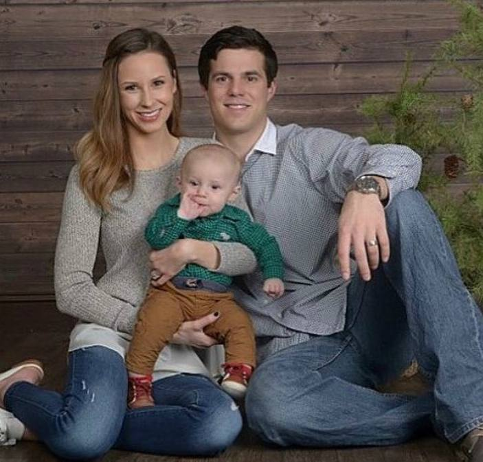 Ashlen Cyr with her husband and child