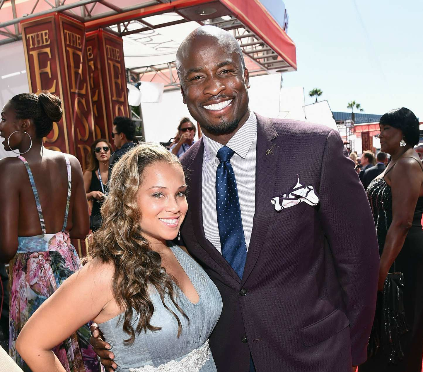 Akbar Gbajabiamila with wife Eileen Gbaja-Biamila, attends The 2014 ESPYS at Nokia Theatre L.A. Live on July 16, 2014 in Los Angeles, California