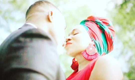 India Arie kissing her co-actor in her music video