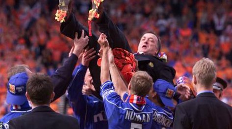 Dick Advocaat uplift by his player after winning the game