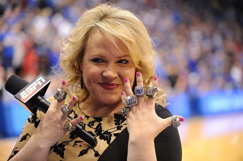 Holly Rowe wearning all the rings while reporting for ESPN