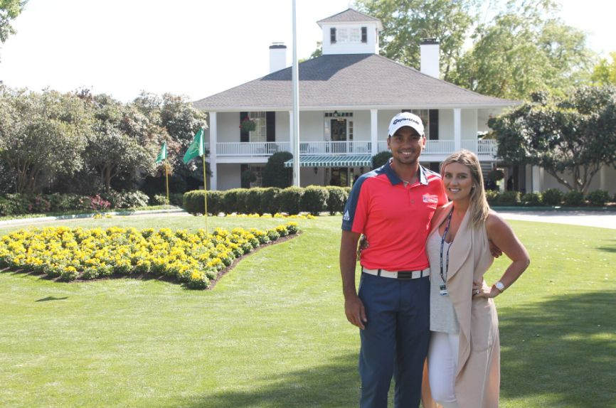 Jason Day in front of house with his wife
