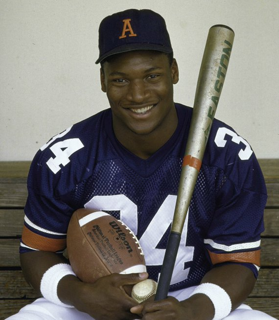 Bo Jackson with his bat and football