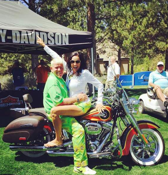 John Daly with a mysterious lady in his bike