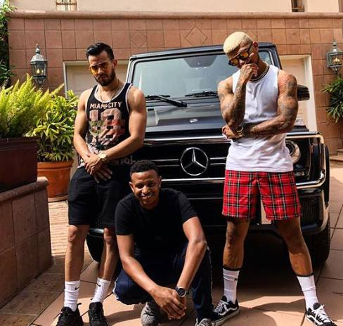 DeAndre Yedlin and his friends posing with his car