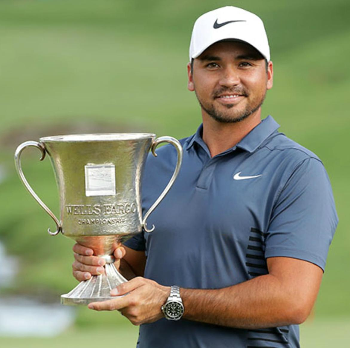 Jason Day holding trophy after his win