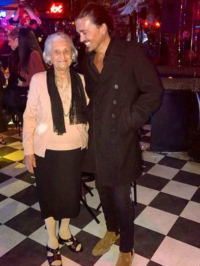 Sidney Torres with his grandmother, Lena Torres