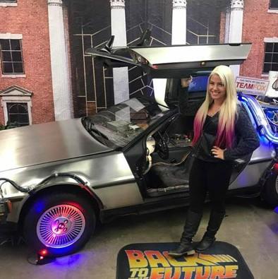 Alexa Bliss American Wrestler in front of her car