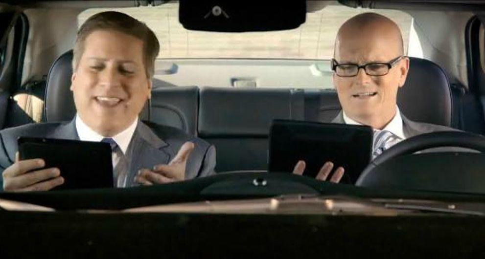 Scott Van Pelt with his co-host inside the car