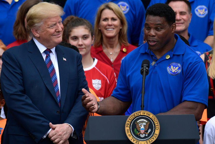Herschel Walker giving speech in front of Trump