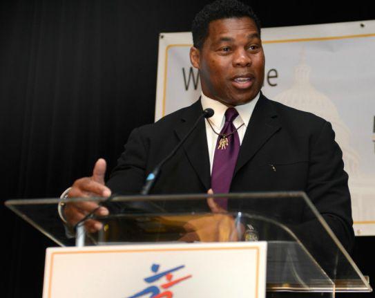 Herschel Walker giving speech in Mental health program