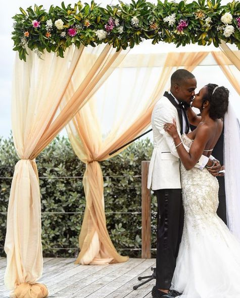 Janai Norman with her husband in their wedding dress