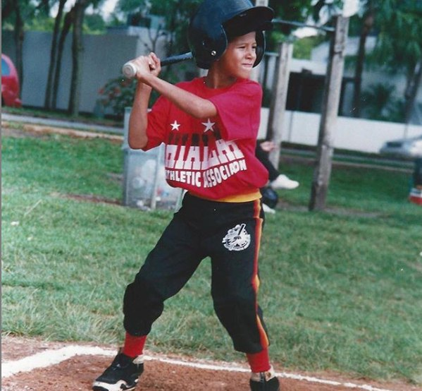 Manny Machado playing baseball in his childhood picture