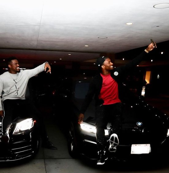Todd Gurley taking selfie with his friends siting in car