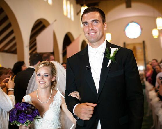 Dana Grady with her husband in their wedding dress