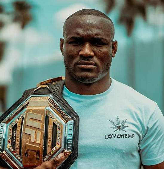 Kamaru Usman with his UFC belt