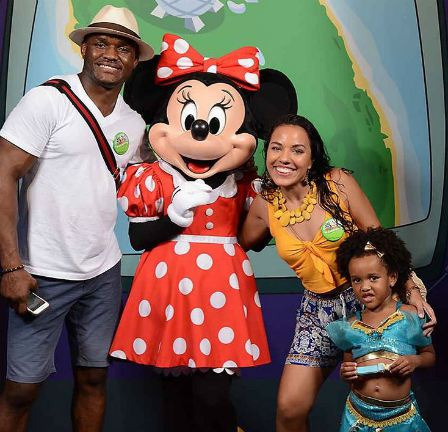 Kamaru Usman with his girlfriend and daughter