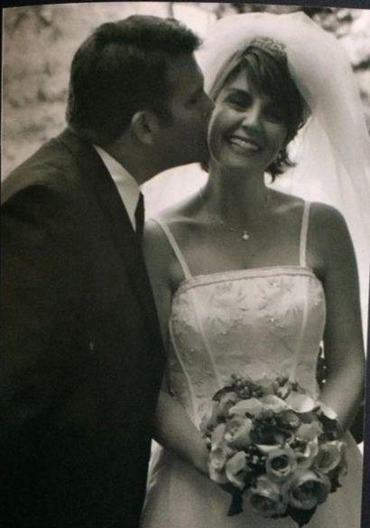 Doug Dunne kissing his wife in their wedding