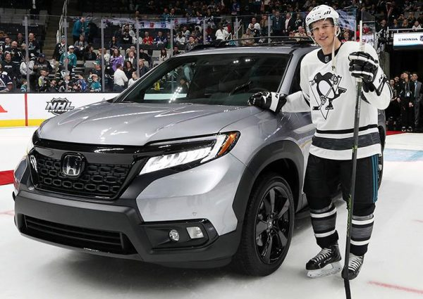 Sidney Crosby standing in front of his car
