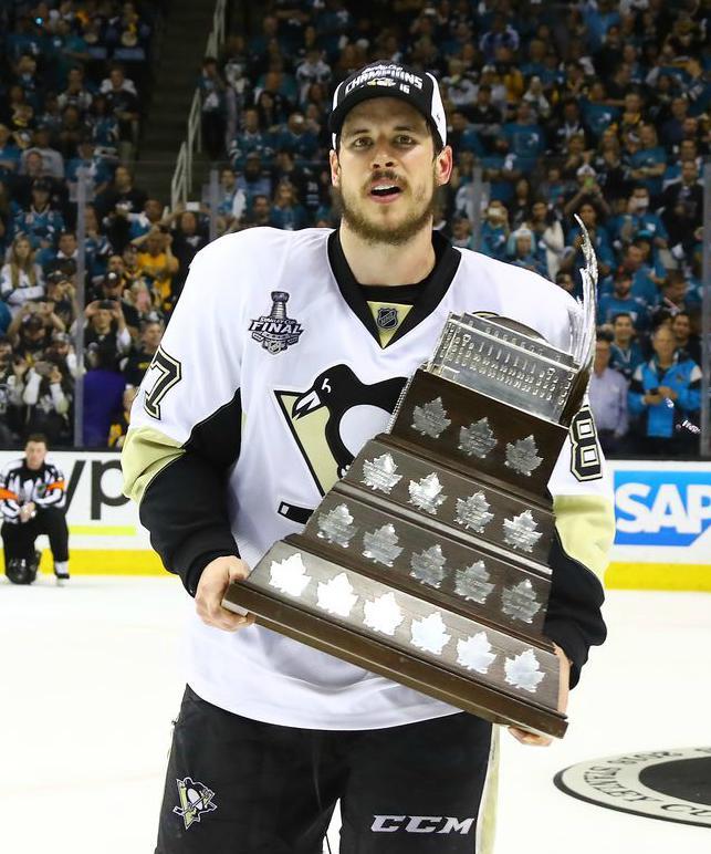 Sidney Crosby holding his award