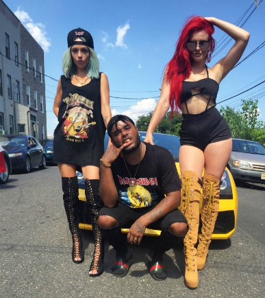 Justina Valentine and her friends posing with a car