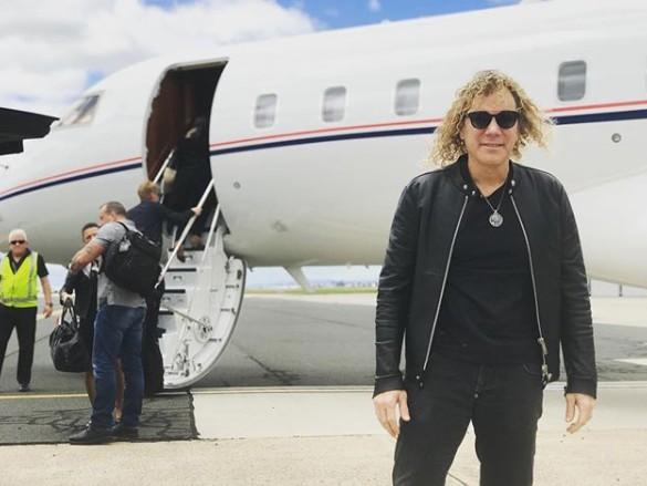 David Bryan travelling through airplane