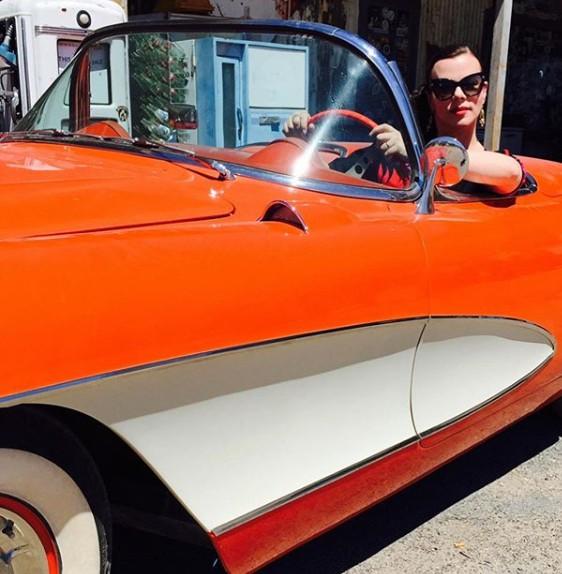 Debi Mazar driving her classic car