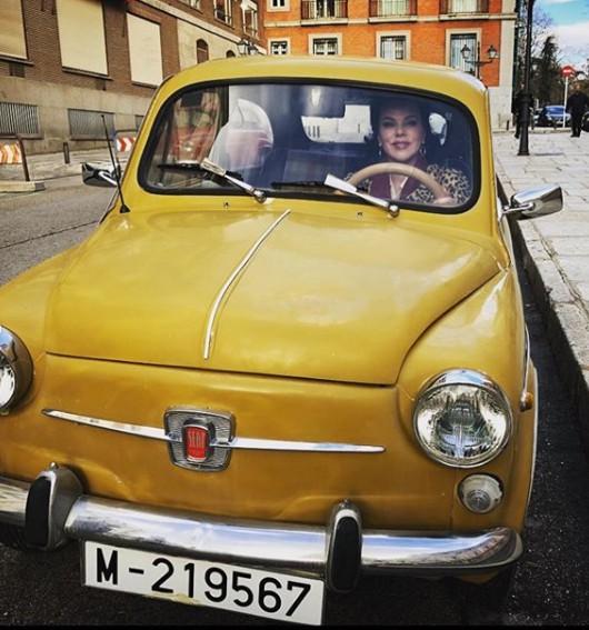 Debi Mazar driving old classic car