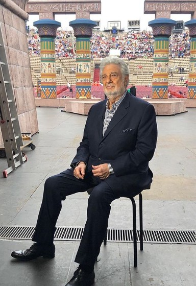 Placido Domingo sitting in chair