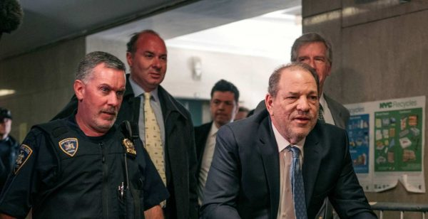 Movie producer Harvey Weinstein (R) enters New York City Criminal Court on February 24, 2020 in New York City