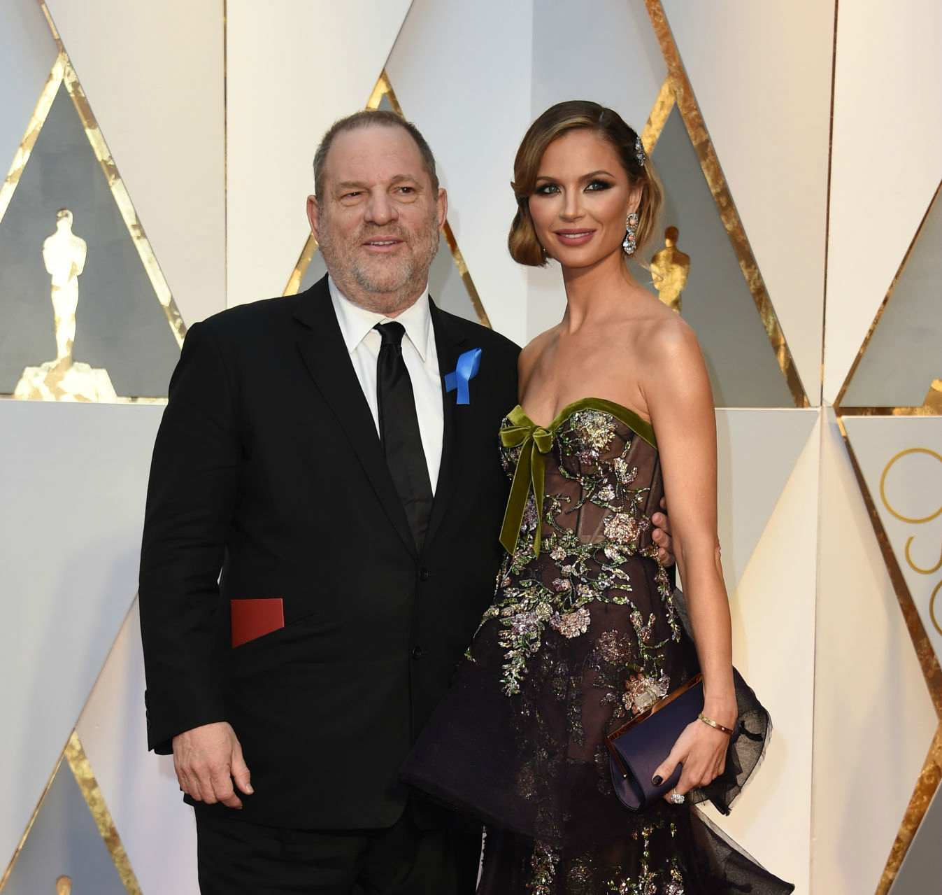 US producer Harvey Weinstein (L) and his wife US designer Georgina Chapman arrive on the red carpet for the 89th Oscars on February 26, 2017 in Hollywood, California