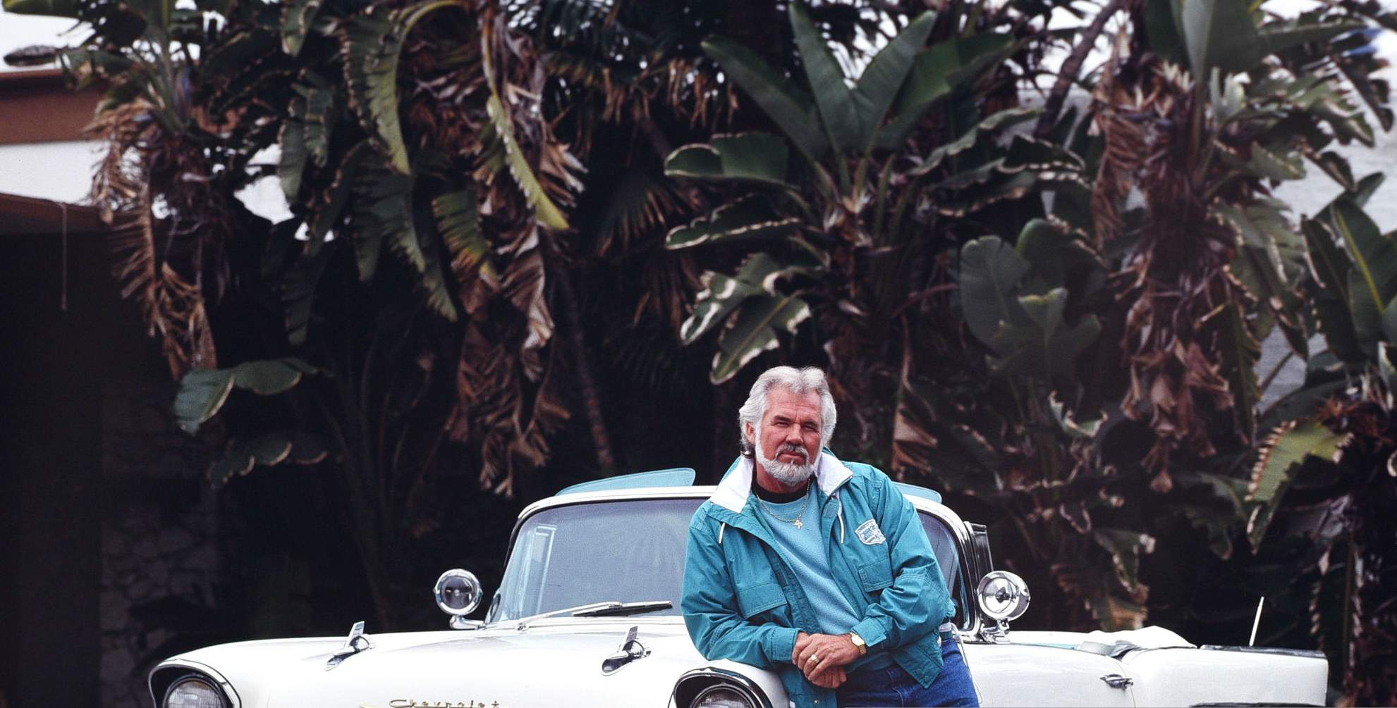 Marianne Gordon's late husband Kenny Rogers with his 1957 convertible Cadillac January 15, 1990 in Beverly Hills, Los Angeles, California