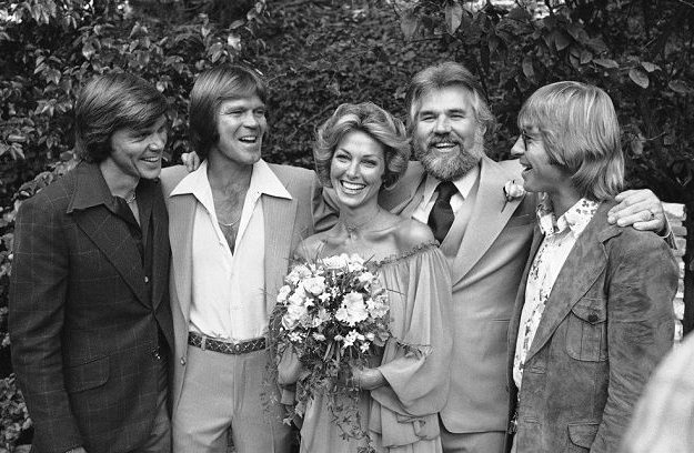 Marianne Gordon with her husband in their wedding dress with their friends