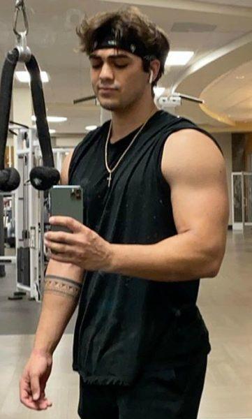 Thomas Petrou taking selfie in gym hall