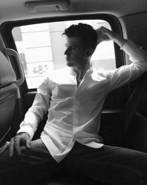 Alvaro Rico sitting inside the car
