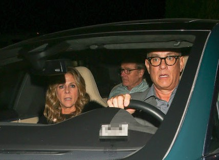 Rita Wilson inside the car while her husband is driving