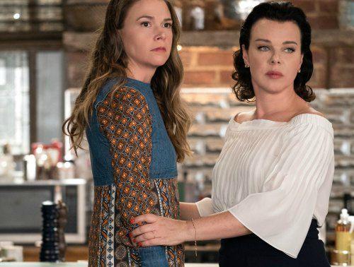 Debi Mazar acting with her co-actor in tv series
