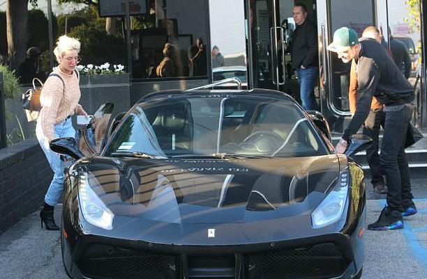 Chris Frangipane's daughter Halsey entering her ferrari car