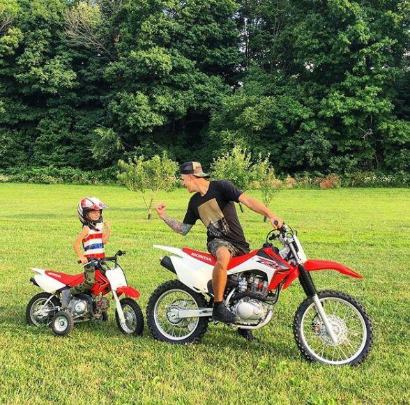 Shanna Riley ex-husband Roman riding bike with his son