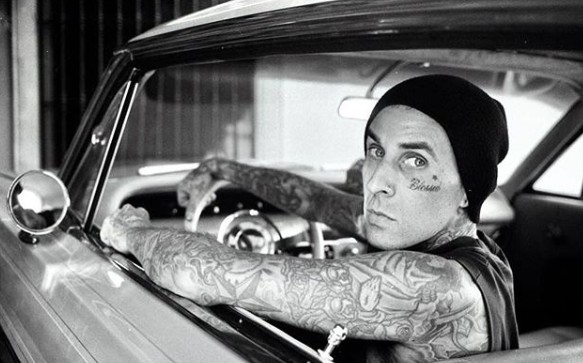 Travis Barker posing for a sitting inside the car