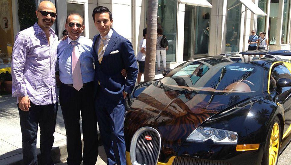 Preetha Jobrani's husband Maz posing for photo with a car
