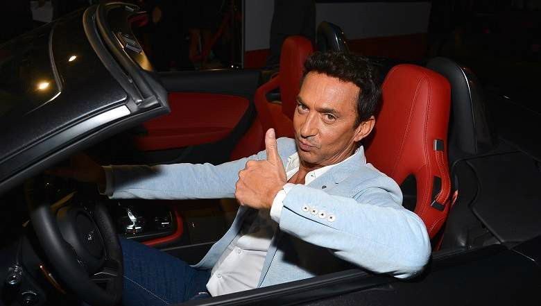 Jason Schanne's partner Bruno sitting inside his car