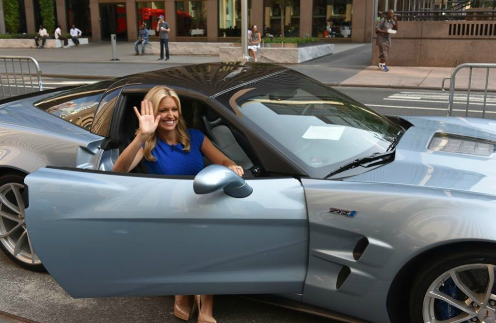 Ainsley Earhardt coming out of her car waving