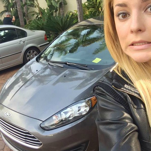 Grace Helbig clicking selfie with her car after getting tickets